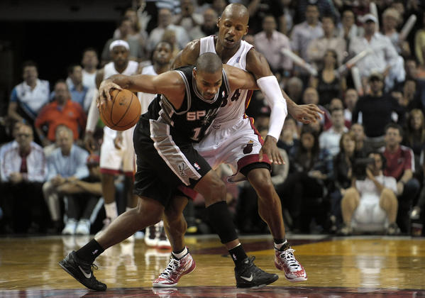 Miami Heat guard Ray Allen guards San Antonio Spurs guard Gary Neal during the second half of their game.