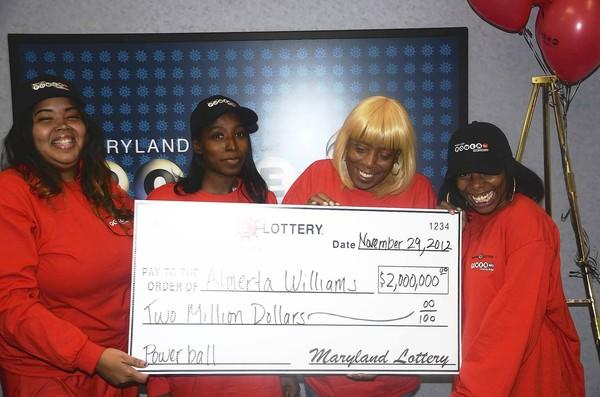 Almerta Williams of Edgewood, third from left, was a $2 million winner in Wednesday's multi-state Powerball drawing. She is pictured at Maryland Lottery headquarters in Baltimore with, from left, Sharonda Harden, niece; Shawnice Perry, daughter; and Brandi Thomison, daughter.