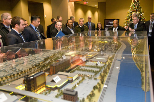 Sands Casino President Robert DeSalvio (right) shows the model of the Master Plan for the former Bethlehem Steel Site in the hotel at the Casino to a delegation from the greater Springfield Massachusetts area on Thursday.