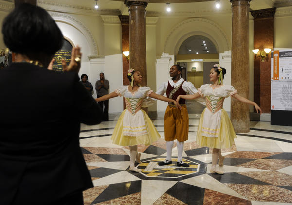 Mayor Stephanie Rawlings Blake, left, applauds as students from the Baltimore School for the Arts surprise her with a dance performance at City Hall this afternoon. Students left to right are: Kaylah Smith, Jared Kelly and Lauren Simmons. They were promoting an upcoming production of The Nutcracker, which will be a collaboration between their school and the Baltimore Symphony Orchestra, MICA and the Lyric.