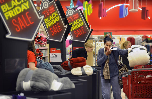 Delaura Parker, of Towson, places a Black Friday sale item into her shopping cart at the Towson Target store. Parker said she has been out shopping since six o'clock Thanksgiving night. Shoppers found no lines at the Towson Target store early on Black Friday because the store opened at 9 p.m. on Thanksgiving.