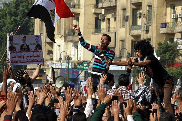 An Egyptian protester shouts slogans against President Mohamed Morsi during a rally in Cairo's Tahrir Square on Friday against his rule by decree and a constitution largely drafted by Islamists.