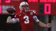 INDIANAPOLIS -- The Big Ten's total offense rankings reveal a total picture of the conference's two best quarterbacks.