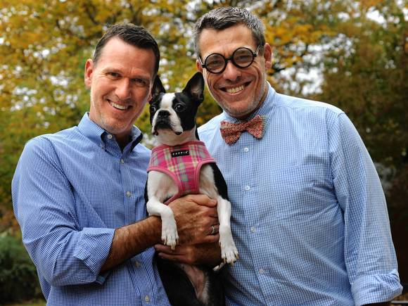 Tom Boeke, left, gave Mirabelle, a Boston Terrier, to Michael Muller, right.