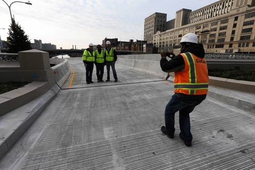 Shakir Hussain takes a photo of co-workers Daniel Gross, Benesch vice-president and construction management services, Brad Bacilek and Neresh Jindel at the Upper Wacker Drive ramp leading south in downtown Chicago.