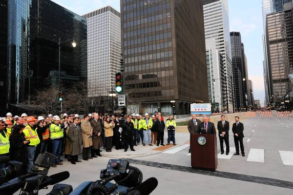 Gov. Pat Quinn holds a press conference at the Upper Wacker Drive-Van Buren Street intersection as Wacker Drive is reopened.