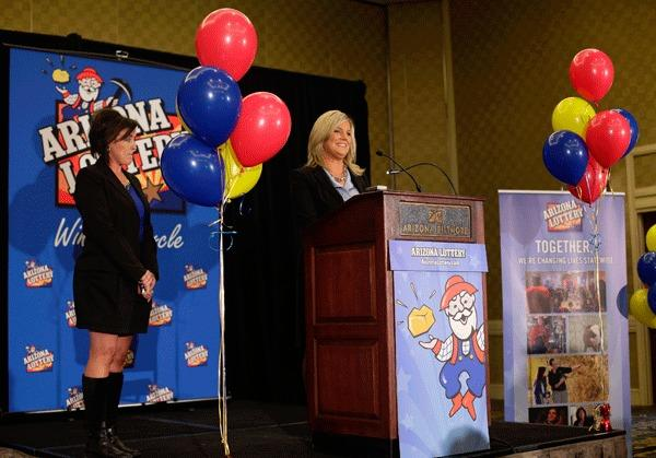 Arizona Lottery spokeswoman Karen Bach speaks about one of two winning Powerball lottery tickets that was sold in Fountain Hills, Arizona November 29, 2012.
