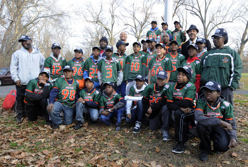 The undefeated Hartford Hurricanes football team gather for a team picture before the group boarded a bus for Orlando, Florida to play in the national Pop Warner football championship after winning the New England finals last weekend.