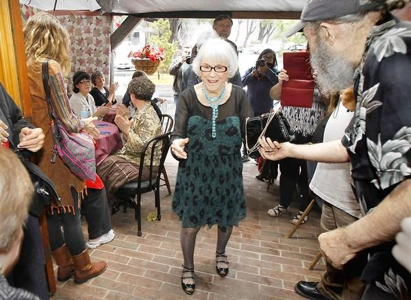 Viola Smith arrives at her 100th birthday party with a rousing ovation and live music at the Piecemakers Country Store in Costa Mesa on Thursday.