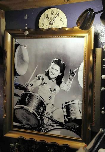A studio publicity photo of Viola Smith playing the drums adorns the wall of the Piecemakers store in Costa Mesa.