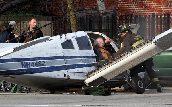 "Actors create a plane crash for the ""Chicago Fire"" television series in the 3100 block of South Martin Luther King Drive in Chicago."