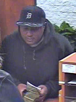 A bank robbery suspect is seen on surveillance video.