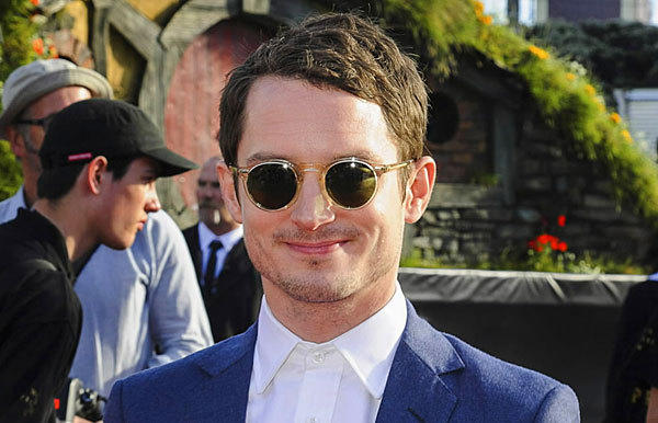 "Actor Elijah Wood mugs for the paparazzi at the world premiere of ""The Hobbit -- An Unexpected Journey"" in Wellington, Australia."