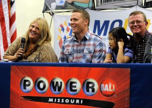 (L - R) Cindy Hill talks about winning the record Powerball Lottery as son, Jason, daughter Jaiden husband Mark looks on during a news conference, November 30, 2012.