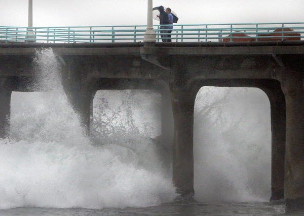 The latest storm generates large surf breaking just underneath the Manhattan Beach Pier.