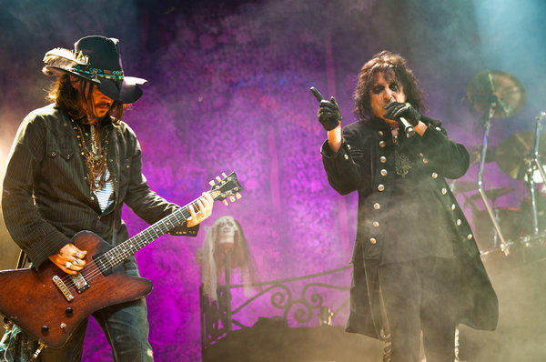 Johnny Depp, left, joined Alice Cooper for Thursday's show at the Orpheum Theatre in Los Angeles.