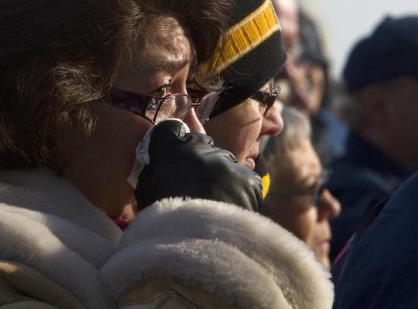 "Maria Elena Girty weeps during a memorial service held Friday morning to honor the victims of the 1969 flight deck fire aboard the USS Enterprise. Girty traveled to Norfolk from California to honor her husband Delvert D. Girty, who was killed in the fire. ""It's very emotional to be aboard the place where my husband was killed,"" she said. ""I wanted my son to be able to come pay his respects to his father he never knew."""