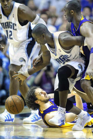 Pau Gasol loses the ball to the Orlando Magic's Mickael Pietrus as Kobe Bryant tries to get it back in Game 3 of the 2009 NBA Finals.
