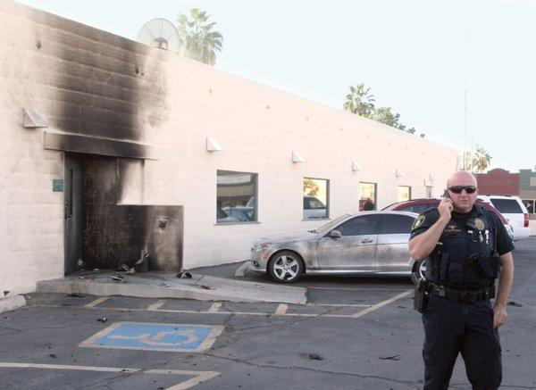 Police investigate an explosion at the Social Security Administration office in downtown Casa Grande, Ariz.