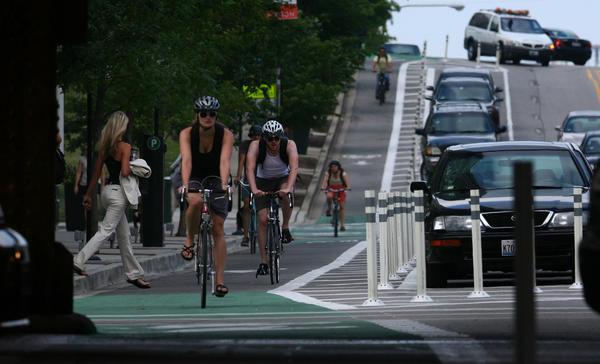 Cyclists ride down Kinzie Street near Jefferson Street.