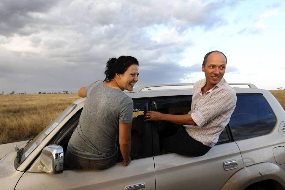Lincoln Park Zoo researcher Anna Czupryna, left, and Lincoln Park Zoo Director of Tanzanian Programs Felix Lankester have a laugh as they take a look outside of their vehicle during a game drive in Serengeti National Park in Northern Tanzania.