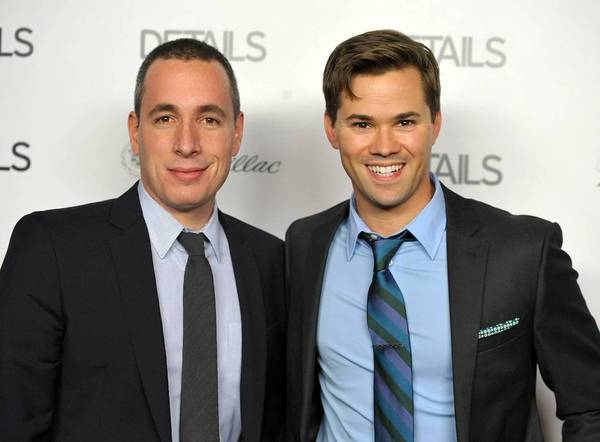 "Dan Peres, left, editor of Details magazine, welcomes ""The New Normal"" star Andrew Rannells to the Hollywood Mavericks celebration on Thursday in Los Angeles."