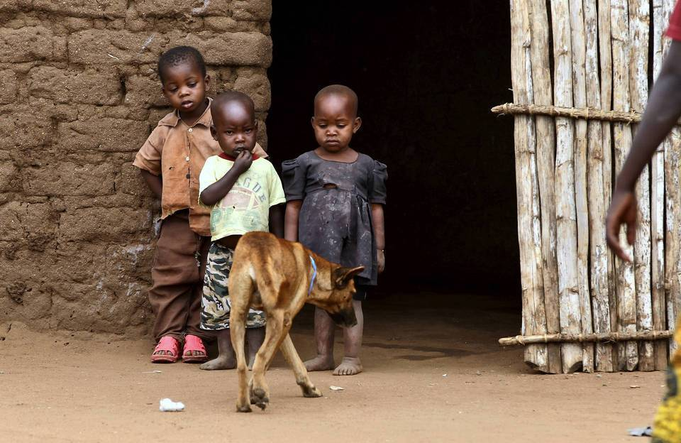 Children stand beside a family dog in the village of Nangale in Northwest Tanzania.