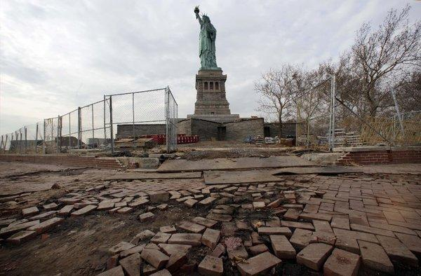 Sandy chewed up the sidewalks around the Statue of Liberty. The island's power plants were also hit hard.