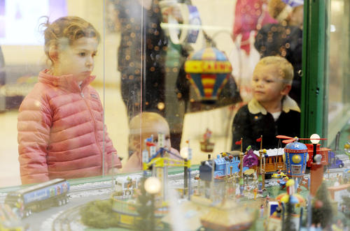 From left, sisters Jane Hughes, 3, and Molly Hughes, 1, of Baltimore, and Griffin Weber, 2, of White Hall stare at the train garden at The Shops at Kenilworth on Friday, Nov. 30.