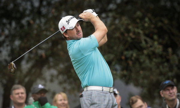 Graeme McDowell watches his tee shot at No. 2 on Friday during the second round of the World Challenge at Sherwood Country Club in Thousand Oaks.