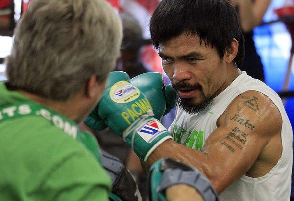 Boxing champion Manny Pacquiao works out with trainer Freddie Roach at the Wild Card Boxing Club in Hollywood earlier this year.