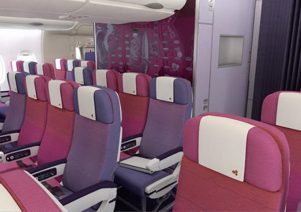 Economy seats, each 18 inches wide, occupy the entire main cabin as well as the rear of the upper cabin.