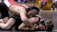 The Maize High School wrestling team will open its season in tournament play Saturday, Dec. 1, and coach Mike Schauer said the Eagle squad must grow up in a hurry.