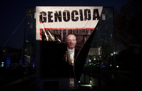 A banner with a defaced picture of Mexican President Felipe Calderon was hung by demonstrators protesting violence in Mexico City on Nov. 28, 2012. Mexico will inaugurate a new president Saturday after Calderon's six-year militarized offensive against drug cartels.