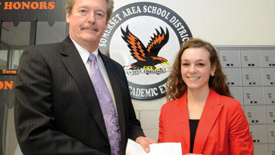 Bill Rice of Laurel Highlands Financial Services, left, presents the volleyball Player of the Week Scholarship to Somerset¿s Jayna Coyle.