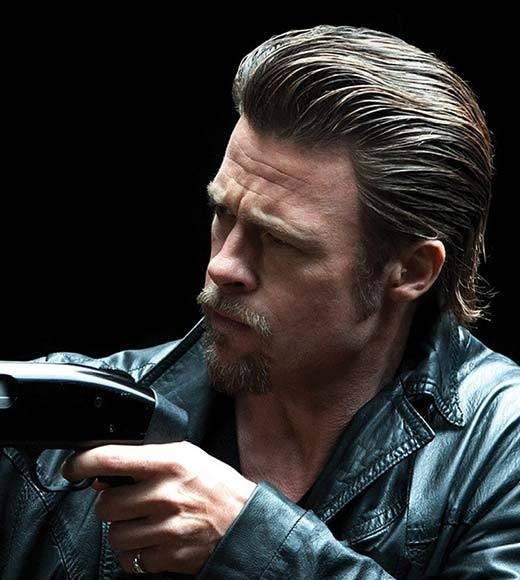 The (Bad) Hair Club for (Bad) Men: Javier Bardem, Brad Pitt, Will Ferrell and more members: Jackie may kill them softly, but that same softness doesnt apply to his hair. Its greased up and slicked back with enough of a forehead bump to make even Snooki tell him to maybe dial it back a little.