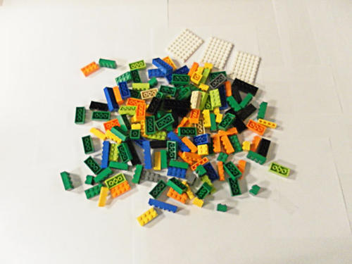 Start with an assortment of Legos. You will need approximately: 25 1x4 pieces, 10 1x1 pieces, 3 6x8 pieces, 125 various 2x2, 2x4 and 2x6 pieces. Note that the size of a Lego is determined by the number of rows and columns of raised Lego bumps. Questions? Lean on lego.com or your local Lego store for answers.