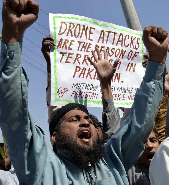 People shout slogans during a protest against U.S. drone attacks in Multan, Pakistan.