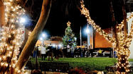 A new tradition began Friday night when the Christmas tree lighting ceremony was held for the first time in the new town square on King Street.
