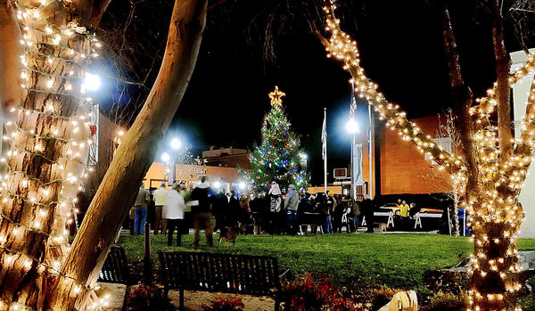 People gather Friday night for the Christmas tree lighting in Martinsburg, W.Va.