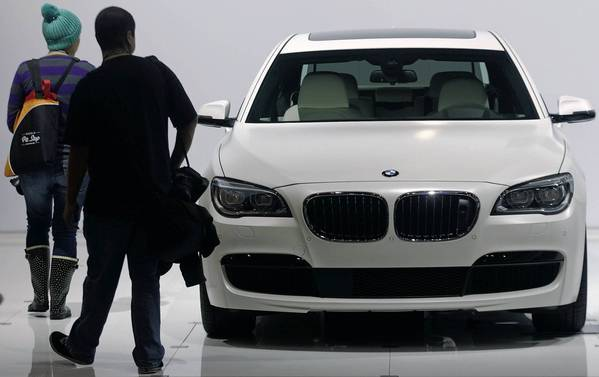 Attendees view a 2013 BMW 750 Li at the L.A. Auto Show, which is open to the public through Dec. 9.