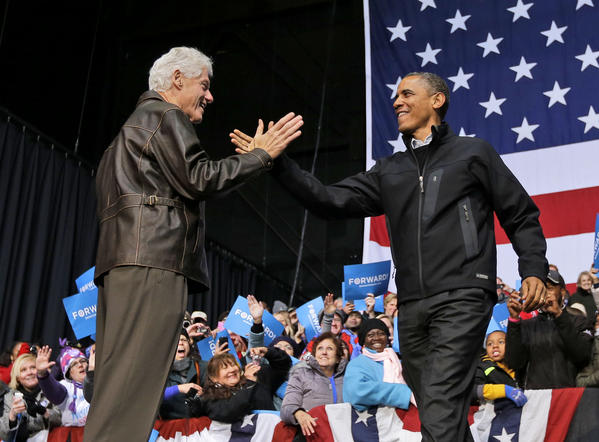 President Barack Obama, right, is introduced by former President Bill Clinton at a campaign event in Bristow, Va. on Nov. 3. Across 26 years of Democratic leadership, unemployment among blacks declined by 7.9%; under 28 years of Republican presidencies, the rate increased by a net of 13.7%, according to census data.
