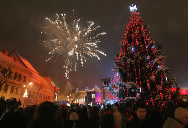 "For the Christmas season, Lithuania's capital city of Vilnius gets covered in colorful garlands of electric lights and the country's largest ""Christmas tree"" (the Vilnius television tower under a vale of lights) is lit up. In the Old Town Christmas Markets, taste festive treats and mulled wine. Then see if you can spot Santa or listen to carols in one of the city's many churches."