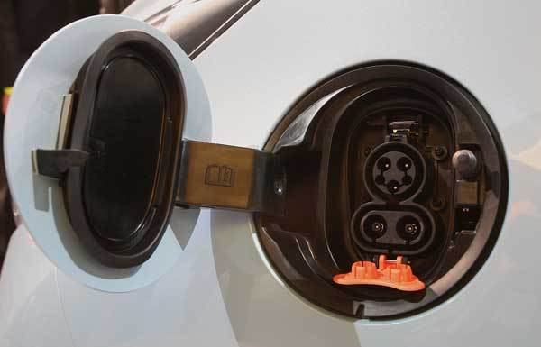 Chevy's new electric vehicle for 2013, the Spark, has an outlet where other cars' gas tanks could be.