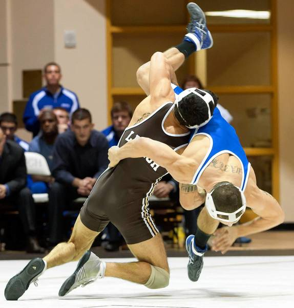 Lehigh's Anthony Salupo (left) wrestles Hofstra's Luke Vaith during their 141 pound match at Lehigh University's Grace Hall on Friday night. Salupo beat Vaith 8-5.