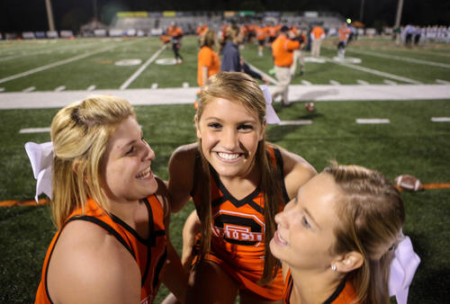 Cheerleaders of Oviedo Lions cheer for their team before the game against Tallahassee Lincoln at Oviedo football field, Oviedo, Fla., Friday, November 30, 2012.