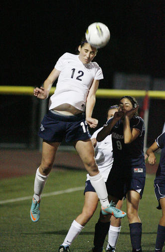 Flintridge Prep's Whitney Cohen jumps highest to head a corner kick clear of her goal against Marshall Fundamental at the Glendale Sports Complex in a non-league girls soccer match on Friday, November 30, 2012.