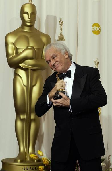 "Martin Richards embraces his Oscar statuette after ""Chicago"" won for best motion picture at the 75th annual Academy Awards in Los Angeles in 2003."