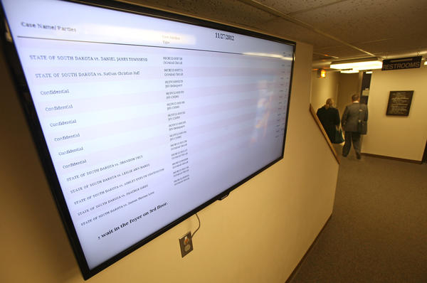 A video board near the main entrance to the Brown County Courthouse lists the names, times and locations of court hearings on a daily basis. There is a second video board on the second floor of the courthouse near the clerk of court's office.