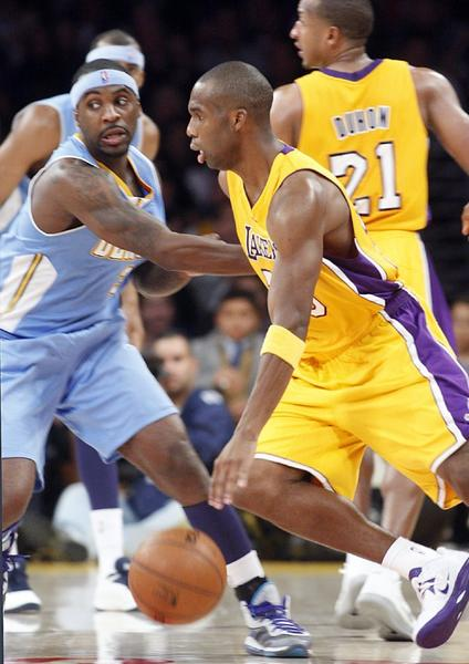 Lakers guard Jodie Meeks takes Nuggets guard Ty Lawson to the basket in the fourth quarter on Friday.